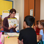 Teacher presenting to elementary students
